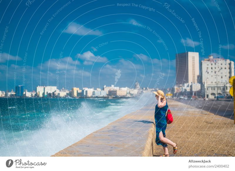 Woman with blue dress and hat at Malecon in Havana Day Summer Blue sky Cuba El Malecón Ocean Water Waves White crest Promenade Coast Skyline Clouds