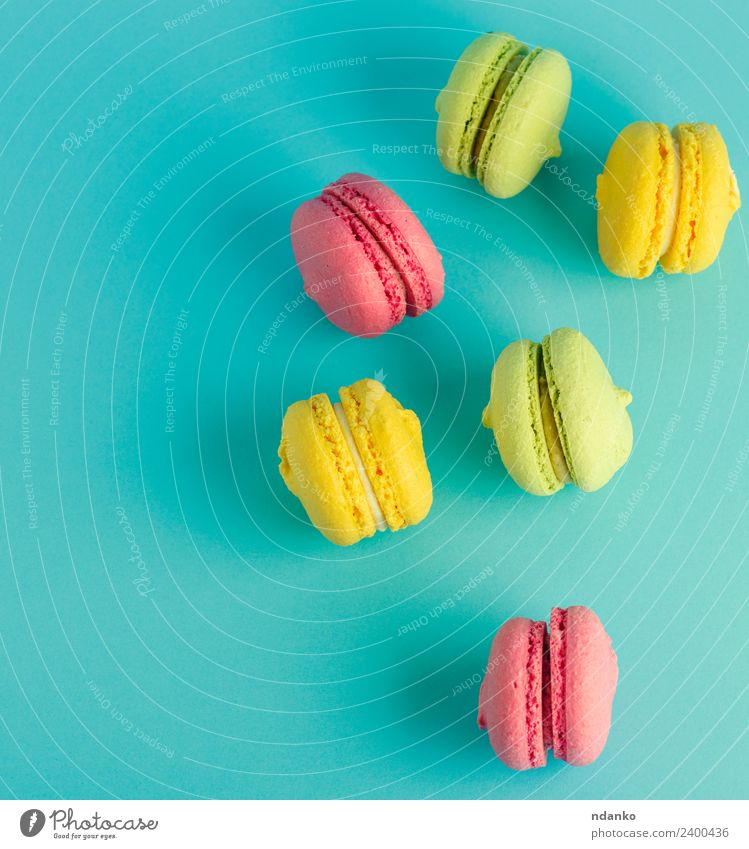 multicolored pastry with almond flour Dessert Candy Eating Bright Blue Yellow Green Pink Colour Macaron pastel background food colorful Vanilla french cake