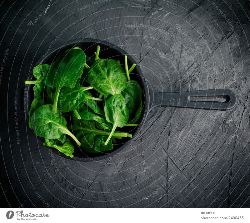 green leaves in a black round frying pan Vegetable Lettuce Salad Herbs and spices Nutrition Vegetarian diet Diet Pan Healthy Eating Table Nature Plant Leaf