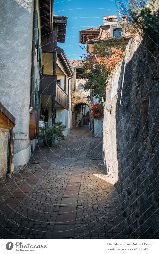 gas Village Blue Gray Green Paving stone Switzerland Street Alley Sky House (Residential Structure) Wall (barrier) Idyll Calm Balcony Colour photo Exterior shot