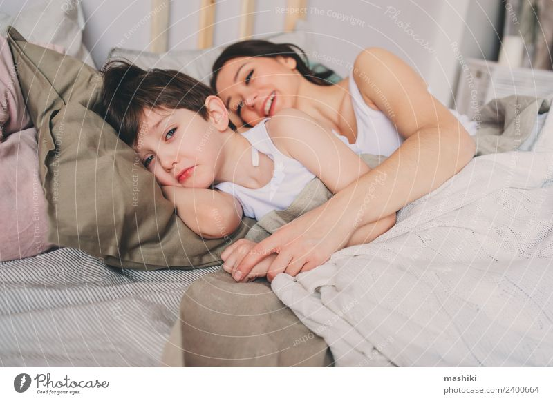 mother and child son sleeping together in bed Lifestyle Relaxation Bedroom Child Toddler Boy (child) Parents Adults Mother Family & Relations Infancy Smiling