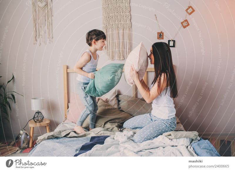 happy mother and child son playing pillow fight Lifestyle Relaxation Bedroom Child Toddler Boy (child) Parents Adults Mother Family & Relations Infancy Smiling