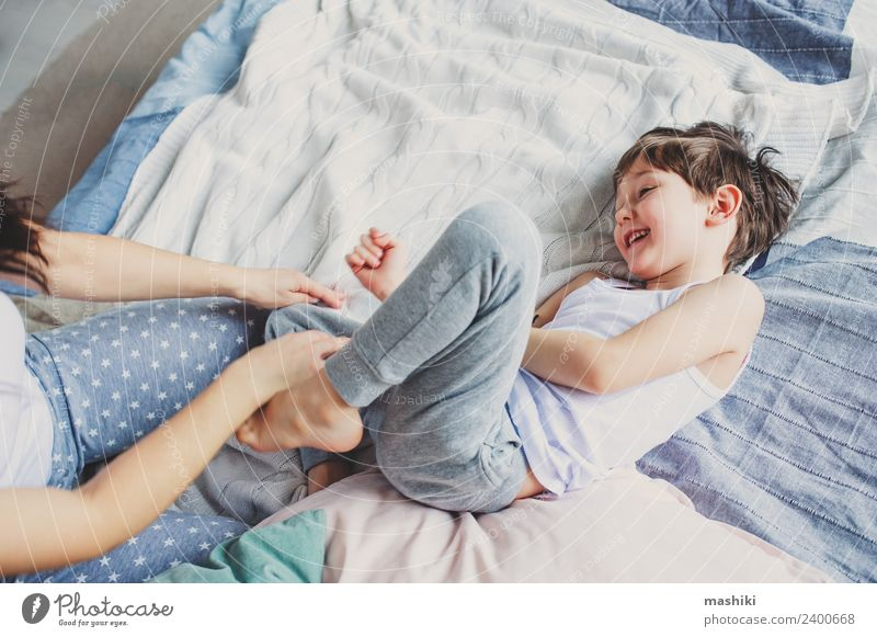happy mother and child son fooling and playing Lifestyle Joy Relaxation Bedroom Child Boy (child) Parents Adults Mother Family & Relations Infancy Smiling