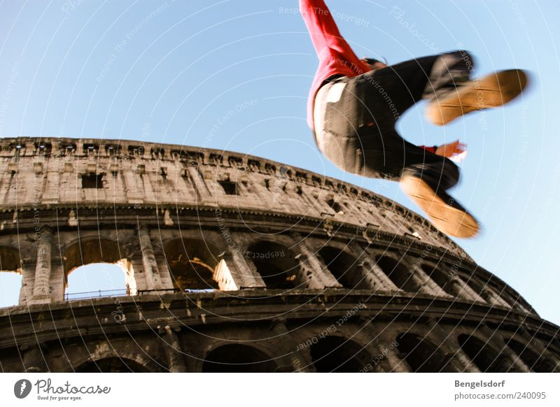 city hopping Leisure and hobbies Young man Youth (Young adults) Legs Feet 1 Human being Tourist Attraction Landmark Colosseum Movement Jump Italy Rome