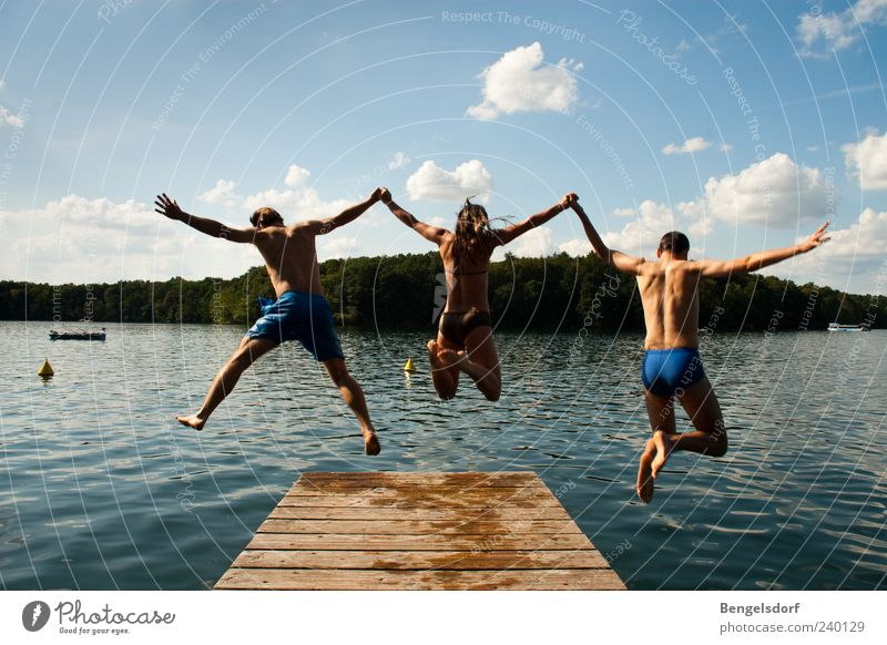 Human being Sky Nature Youth (Young adults) Blue Water Vacation & Travel Summer Clouds Playing Freedom Jump Lake Friendship Young woman Together