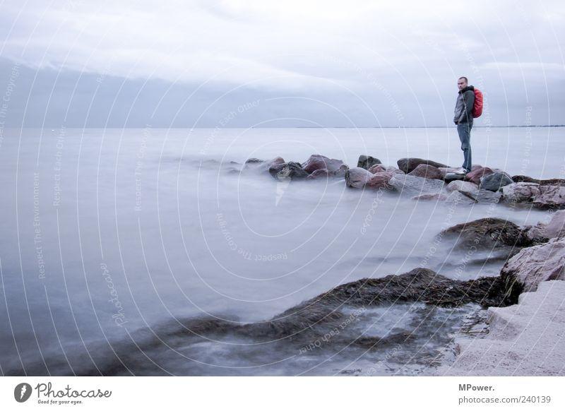 Fehmarn II Baltic Sea Ocean Water Stone Sand Horizon Gray Gloomy Colorless Fog Bad weather Long exposure Waves Clouds Coast Lakeside Beach Rain Man Human being