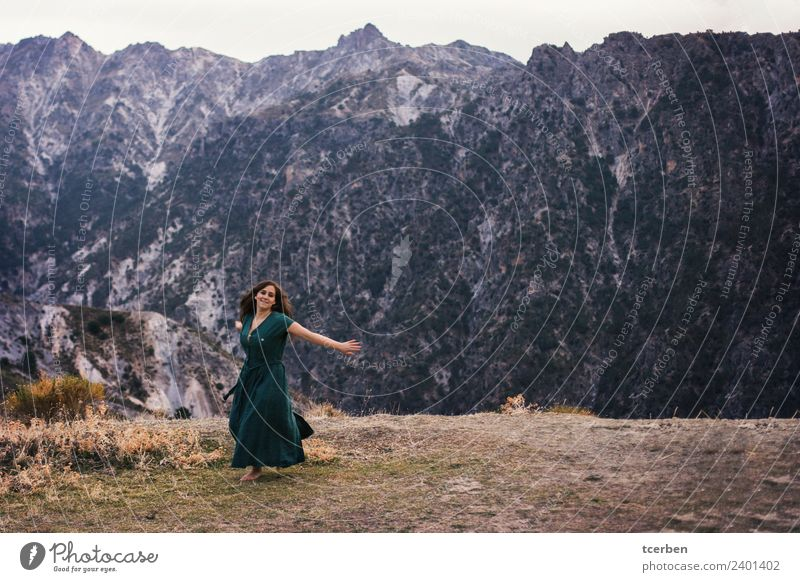 Portrait of a happy woman dancing barefoot on the mountain Lifestyle Feminine Woman Adults 1 Human being 18 - 30 years Youth (Young adults) Landscape Spring