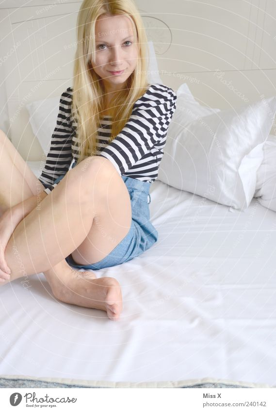 Human being Youth (Young adults) White Beautiful Adults Feminine Hair and hairstyles Legs Young woman Blonde Sit 18 - 30 years Bed Smiling Long-haired Shorts