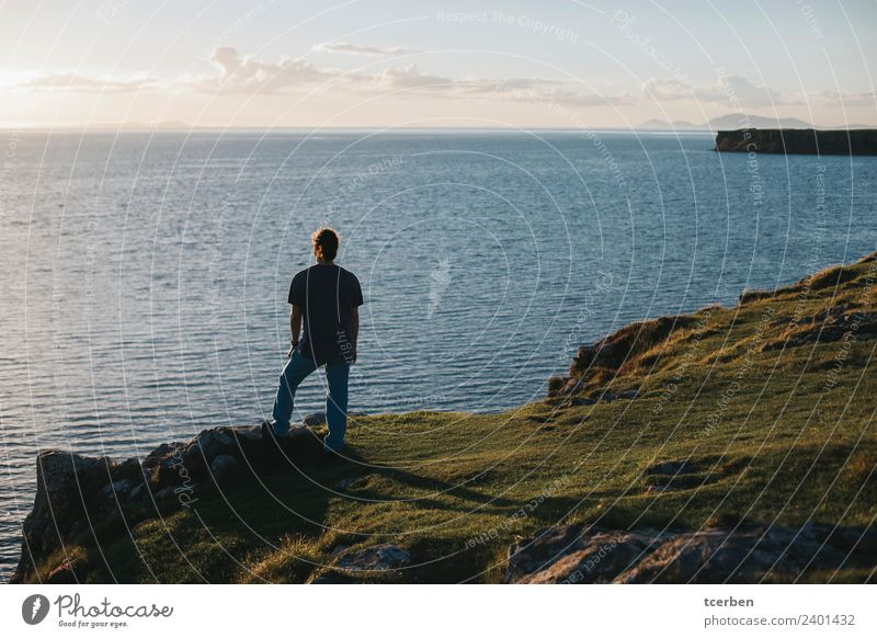 Portrait of back man looking out to sea from a cliff at sunset Human being Sky Vacation & Travel Youth (Young adults) Summer Beautiful Young man Landscape