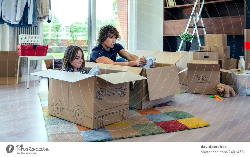 Father and son playing car racing with cardboard boxes Plate Lifestyle Joy Happy Relaxation Playing House (Residential Structure) Moving (to change residence)