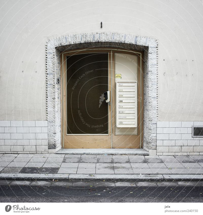 entrance House (Residential Structure) Manmade structures Building Architecture Wall (barrier) Wall (building) Facade Door Mailbox Street Sidewalk Gloomy Gray