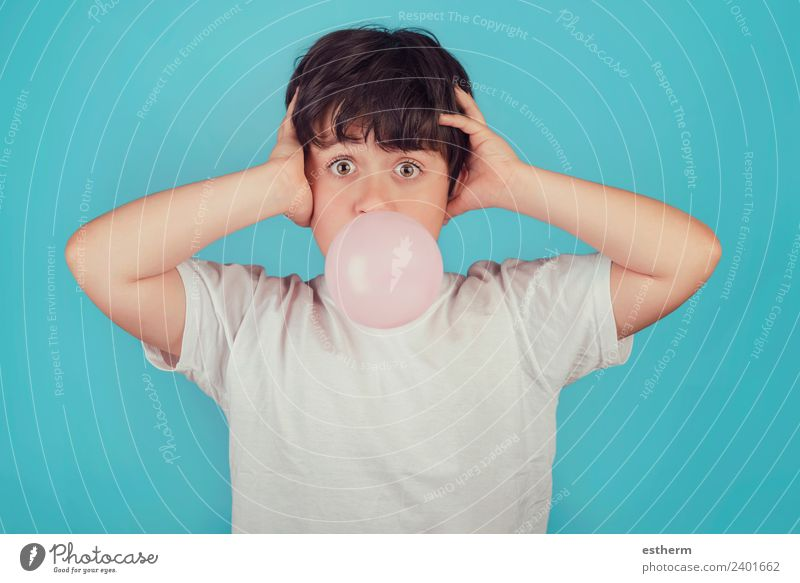 child with chewing gum in your mouth on blue background Child Human being Joy Lifestyle Funny Emotions Movement Food Masculine Infancy Smiling Happiness
