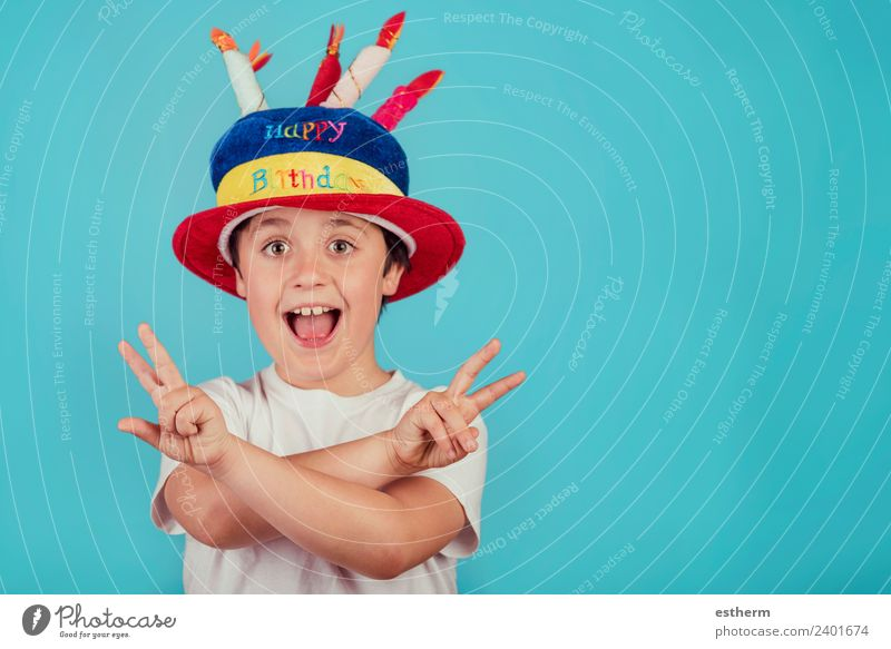 happy boy with birthday hat on blue background Child Human being Joy Lifestyle Funny Emotions Laughter Boy (child) Party Feasts & Celebrations Masculine Infancy
