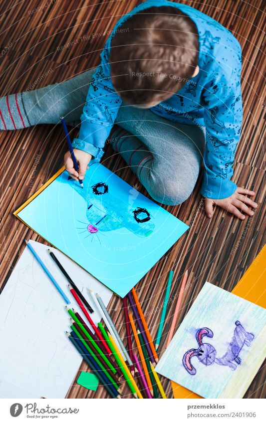 Little boy drawing a colorful picture Lifestyle Joy Handcrafts Education Kindergarten Child School Craft (trade) Human being Boy (child) Family & Relations