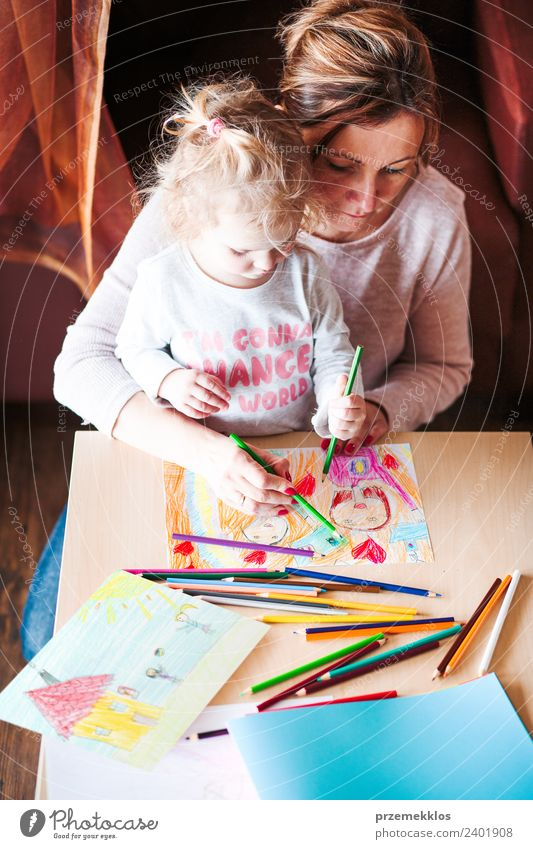 Mom with little daughter drawing the colorful pictures Woman Child Human being Colour Hand Joy Girl Adults Lifestyle Family & Relations Happy Small Art School