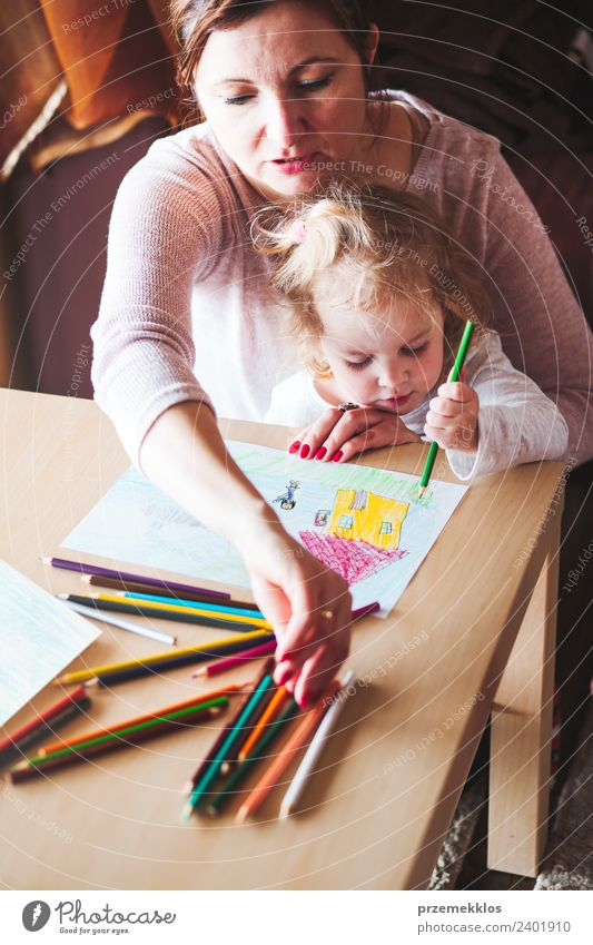 Mom with little daughter drawing the colorful pictures Woman Child Human being Colour Joy Girl Adults Lifestyle Family & Relations Happy Small Art School