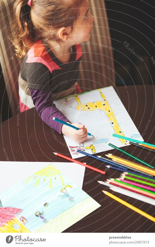 Little girl drawing the colorful pictures Child Human being Colour Joy Girl Lifestyle Happy Small Art School Infancy Creativity Authentic Table Cute Paper