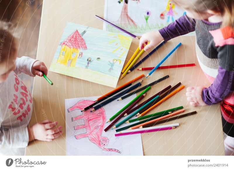 Little girls drawing the colorful pictures Lifestyle Joy Happy Handcrafts Table Kindergarten Child School Craft (trade) Human being Girl Family & Relations