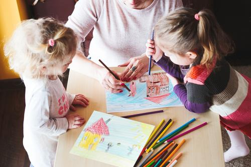 Mom with little girls drawing a colorful pictures Lifestyle Joy Happy Handcrafts Desk Table Kindergarten Child School Craft (trade) Human being Girl Parents