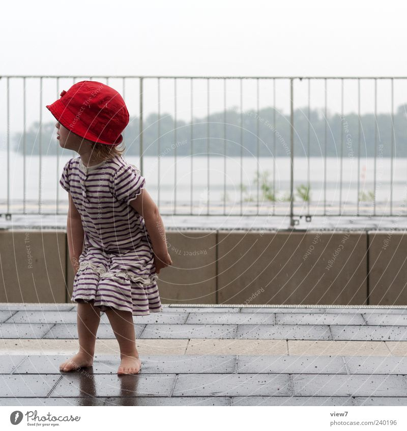 A train will come ... Human being Toddler Girl 1 1 - 3 years Sky Bad weather Rain Transport Train station Platform Dress Hat Cap Line Stripe Observe Discover