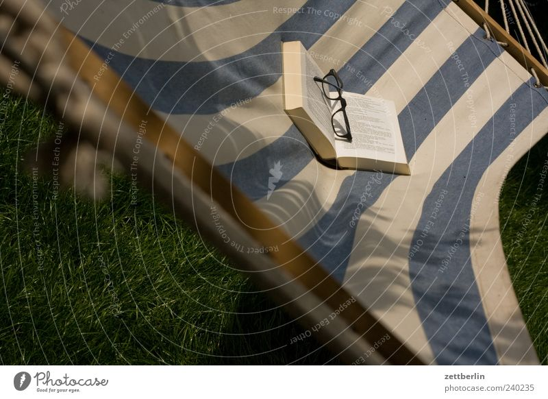 read Relaxation Print media Book To swing Hammock Eyeglasses Stripe Colour photo Exterior shot Deserted Day Deep depth of field Striped 1 Struck Blue White