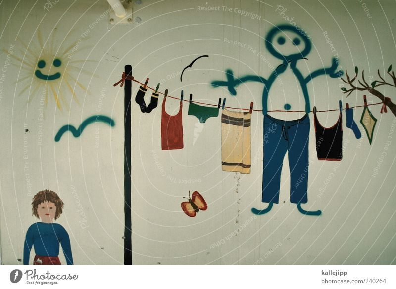 toddler Hang Clothesline Sun Laundry Colour photo Subdued colour Interior shot Painted Wall (building) Childlike Dry Suspended Deserted Symbols and metaphors