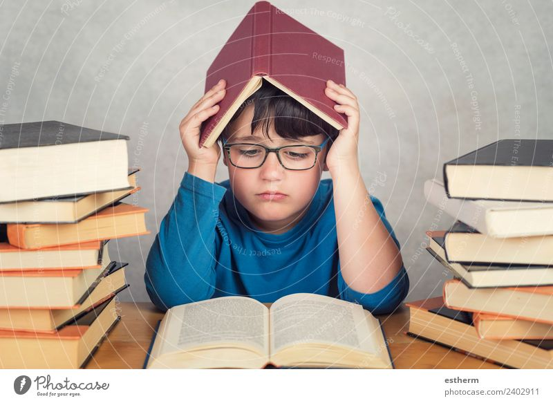 sad and pensive boy with books on a table Child Human being Lifestyle Sadness Emotions School Think Masculine Infancy Study Curiosity Reading To hold on