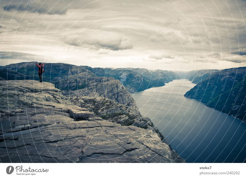 plateau 1 Human being Rock Mountain Peak Fjord Joy Power Adventure Far-off places Target Norway Lysefjord Hiking Pride Subdued colour Exterior shot