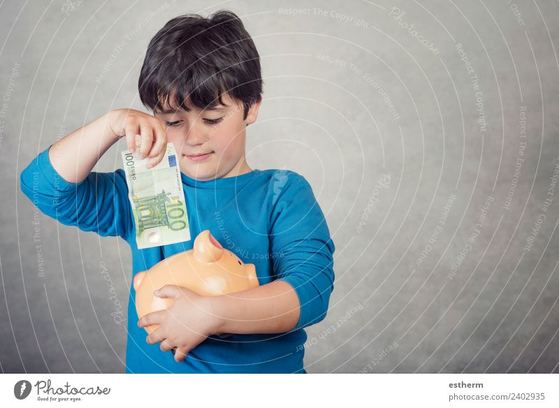 child saving money in a piggy bank on gray background Lifestyle Shopping Luxury Joy Happy Money Human being Masculine Child Toddler Infancy 1 8 - 13 years