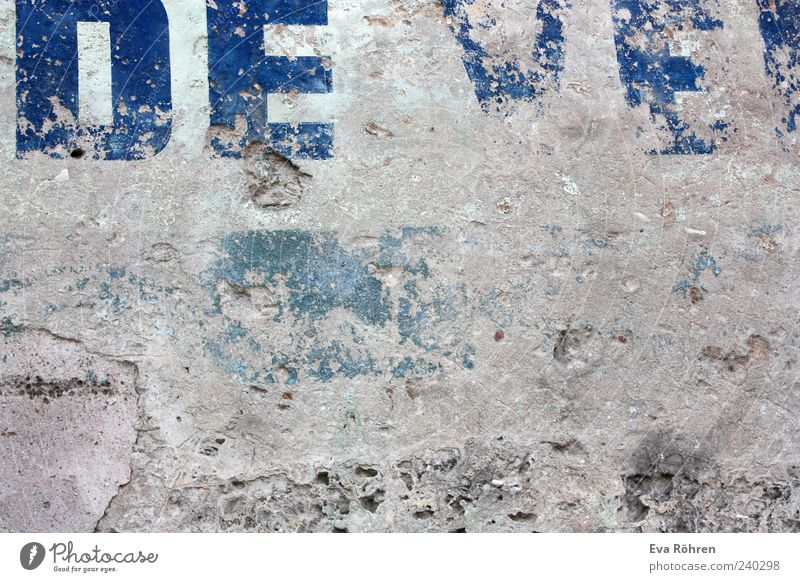 wall Manmade structures Wall (barrier) Wall (building) Facade Stone Concrete Old Blue Gray Decline Transience Destruction Derelict Typography Characters