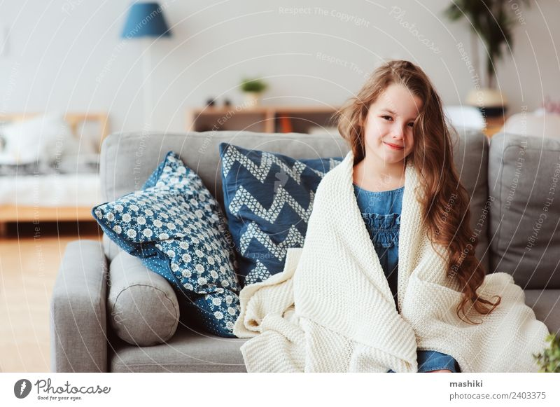 cute little child girl relaxing at home Child Relaxation Winter Warmth Natural Happy Small Modern Sit Smiling To enjoy Living thing Couch Hot Illness Tradition