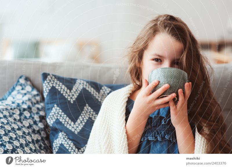 child girl drinking hot tea to recover from flu Tea Illness Relaxation Winter Child To enjoy Smiling Sit Hot Small Modern Natural Tradition kid health cup Wrap