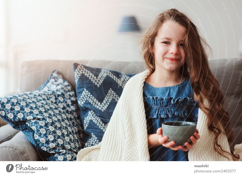 child girl drinking hot tea to recover from flu Tea Illness Relaxation Winter Living room Child Warmth To enjoy Smiling Sit Hot Small Modern Natural Tradition