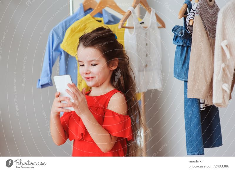little child girl making selfie Shopping Style Happy Child PDA Fashion Clothing Dress Collection Smiling Bright Hip & trendy New Red Colour kid outfit choose
