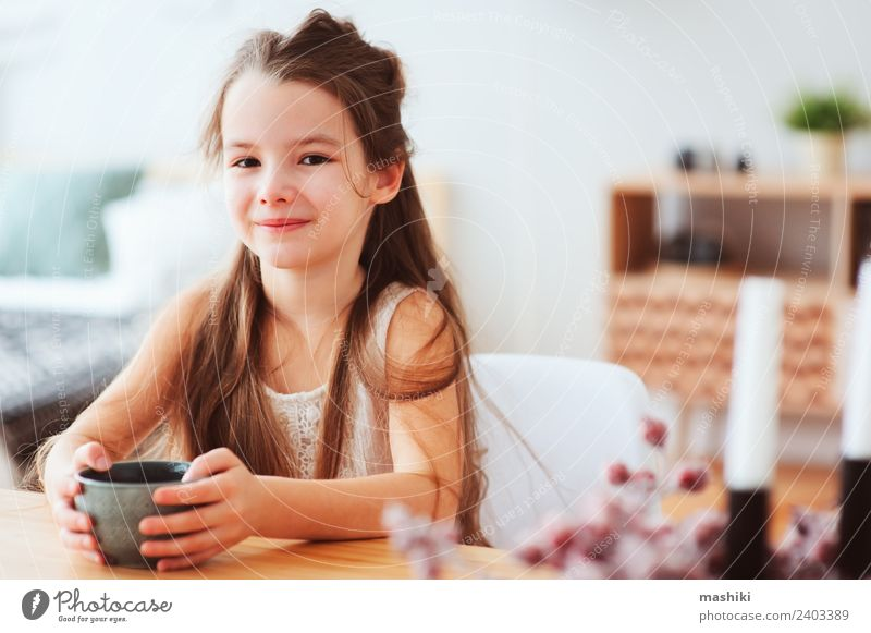 happy 5 years old kid girl having breakfast Nutrition Breakfast Hot Chocolate Tea Lifestyle Happy Table Kitchen Child Infancy Smiling Sit Authentic Modern