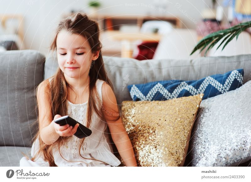 child girl watching tv at home Style Joy Happy Relaxation Living room Child School Technology Television Observe Sit Small Modern Safety (feeling of) Loneliness