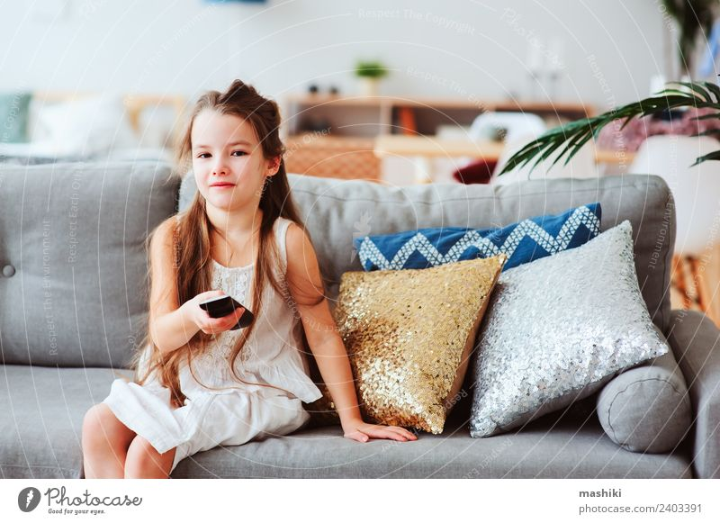 child girl watching tv at home Child Relaxation Loneliness Joy Style Happy Small School Modern Technology Sit Observe Search Home Living room Television