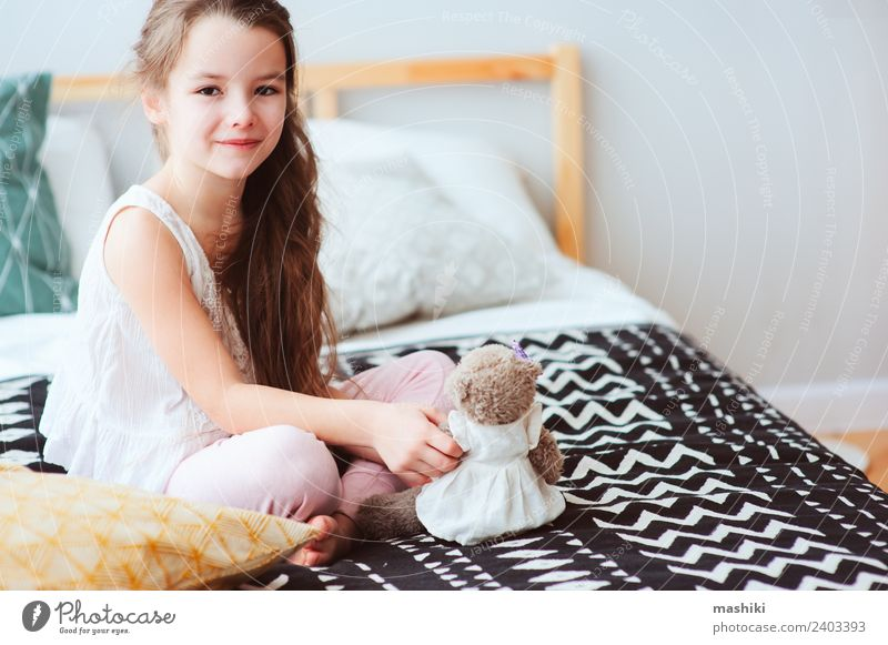 cute happy child girl relaxing at home on the bed Lifestyle Joy Relaxation Bedroom Child Toys Teddy bear Smiling Sleep Dream Small Funny Cute Energy kid Wake up