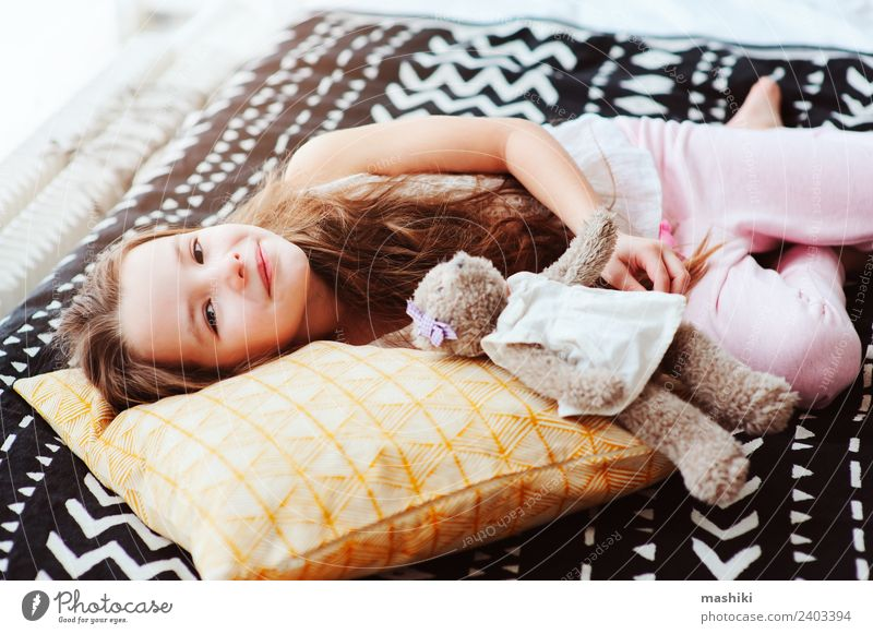 cute happy child girl relaxing at home Child Relaxation Joy Lifestyle Funny Small Dream Smiling Energy Sleep Home Bedroom Rest Wake up Weekend Pillow