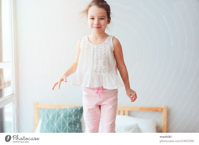 happy kid girl jumping on bed Lifestyle Joy Happy Hair and hairstyles Relaxation Sun Bedroom Child Toys Teddy bear Smiling Sleep Dream Small Funny Cute Energy
