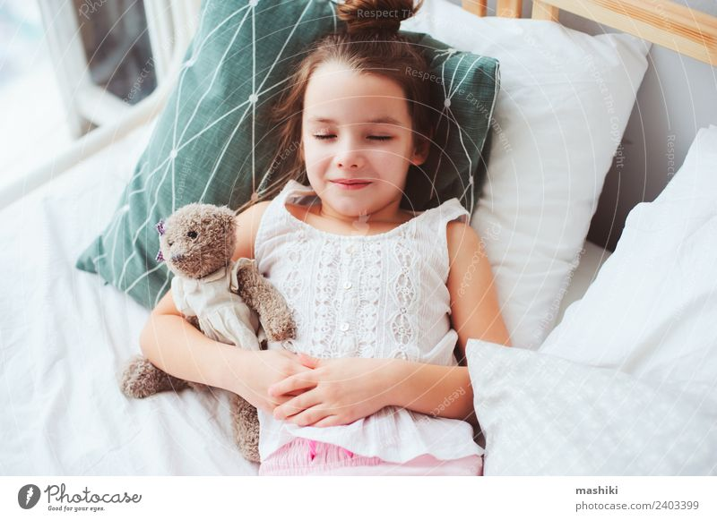 cute little child girl sleeping in comfortable bed. Lifestyle Joy Relaxation Bedroom Child Toys Teddy bear Smiling Sleep Dream Small Funny Cute Energy kid