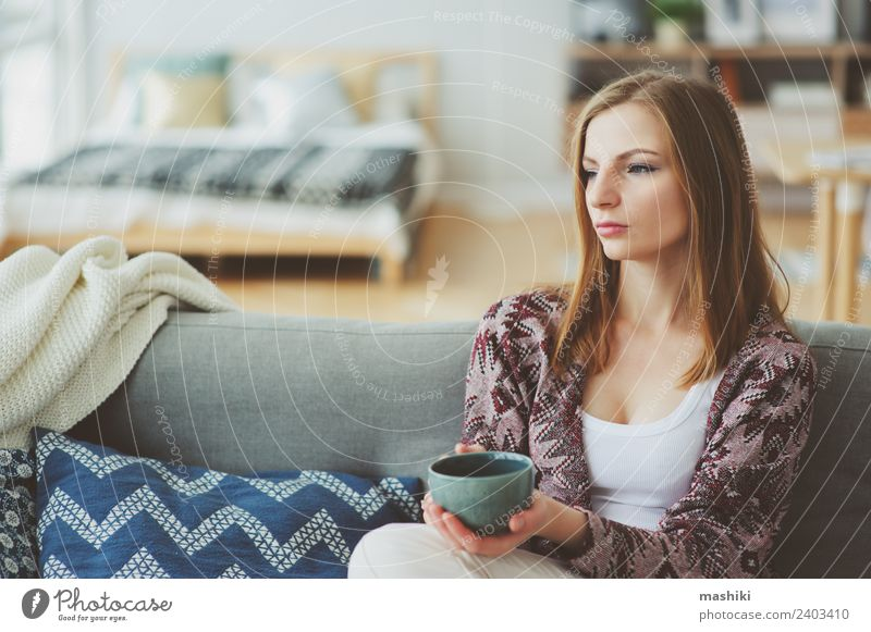 indoor lifestyle portrait of young woman Woman Relaxation Loneliness Adults Lifestyle Sadness Natural Dream Coffee Couch Harmonious Strong Illness Balance Home