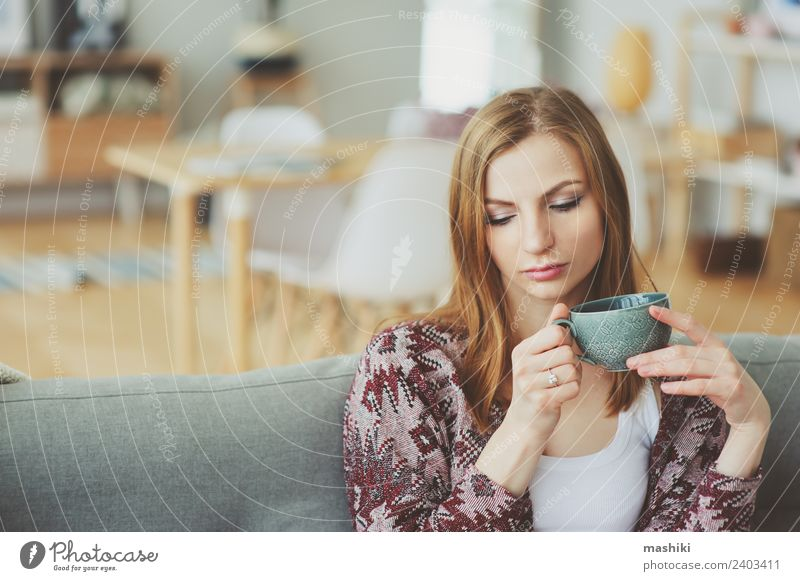 indoor portrait of young thoughtful woman at home Coffee Tea Lifestyle Illness Harmonious Relaxation Flat (apartment) Woman Adults Dream Sadness Modern Natural