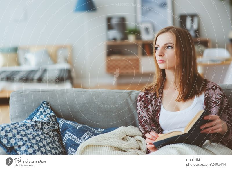 indoor portrait of young thoughtful woman at home Lifestyle Harmonious Relaxation Reading Knit Winter Woman Adults Book Autumn Modern Loneliness Home Cozy calm