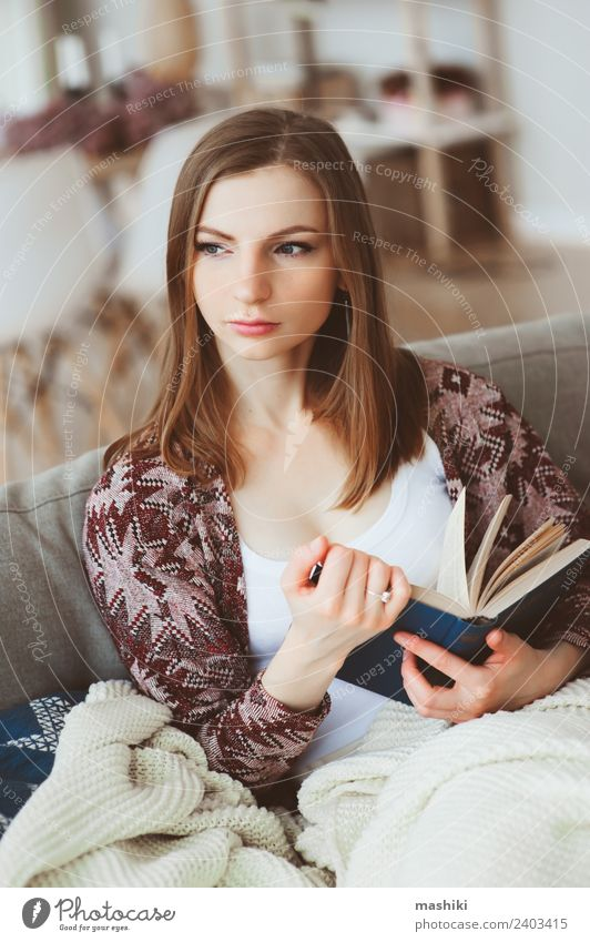 indoor portrait of young thoughtful woman Woman Relaxation Loneliness Winter Adults Lifestyle Autumn Natural Modern Book Reading Couch Harmonious Balance Home