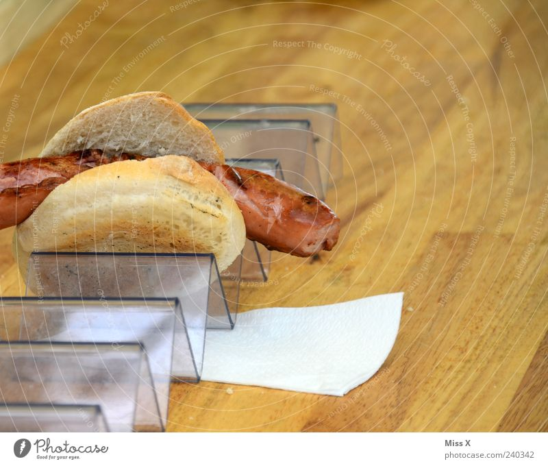 snack Food Sausage Roll Nutrition Fresh Hot Delicious Appetite Snack bar Napkin Wooden table Colour photo Close-up Copy Space right Bratwurst 1 Deserted Bracket