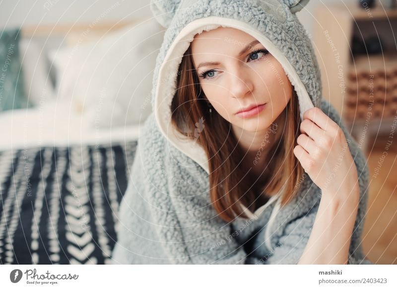 young beautiful woman relaxing at home Lifestyle Relaxation Bedroom Woman Adults Culture Warmth Fashion Sit Dream Funny Modern Natural Gray Loneliness