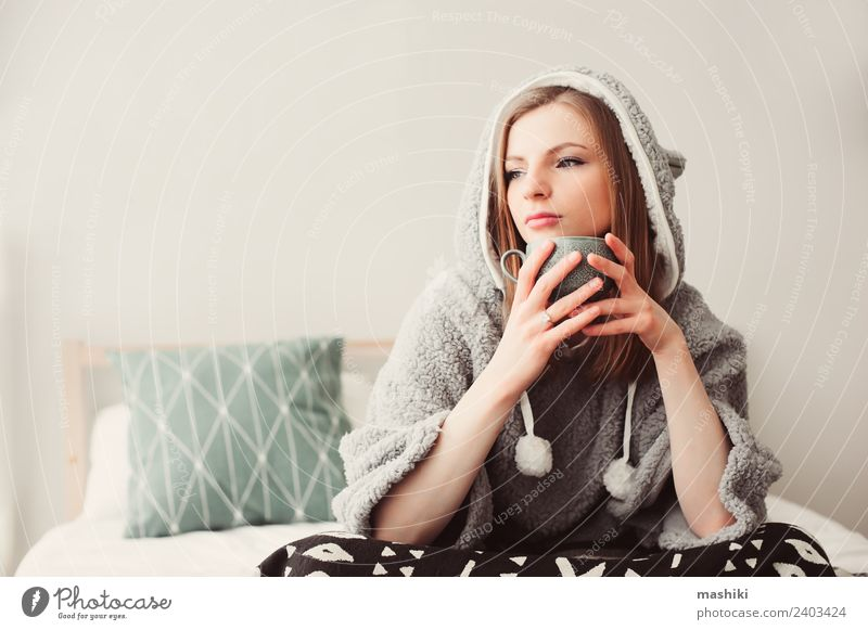 young beautiful woman relaxing at home Woman Relaxation Loneliness Adults Warmth Lifestyle Funny Natural Fashion Gray Dream Modern Sit Culture Coffee