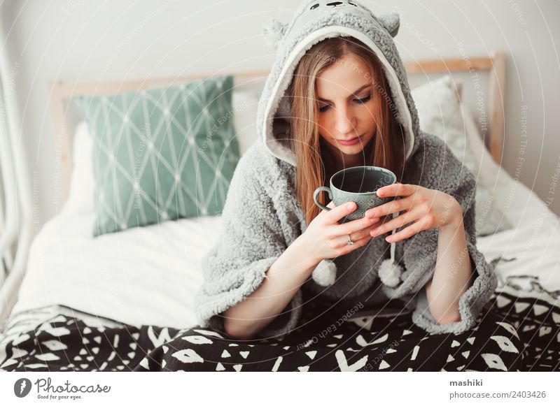 young beautiful woman relaxing at home Coffee Tea Lifestyle Relaxation Bedroom Woman Adults Culture Warmth Fashion Sit Dream Funny Modern Loneliness Considerate