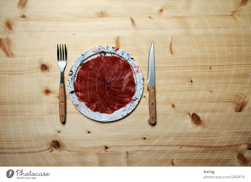 sausage plate Sausage Salami Nutrition Dinner Banquet Plate Cutlery Knives Fork Gluttony Fat Interior shot Copy Space right Copy Space top Copy Space bottom